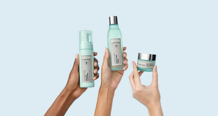 Three hands holding up ARTISTRY SKIN NUTRITION Hydrating Solution products against a blue background