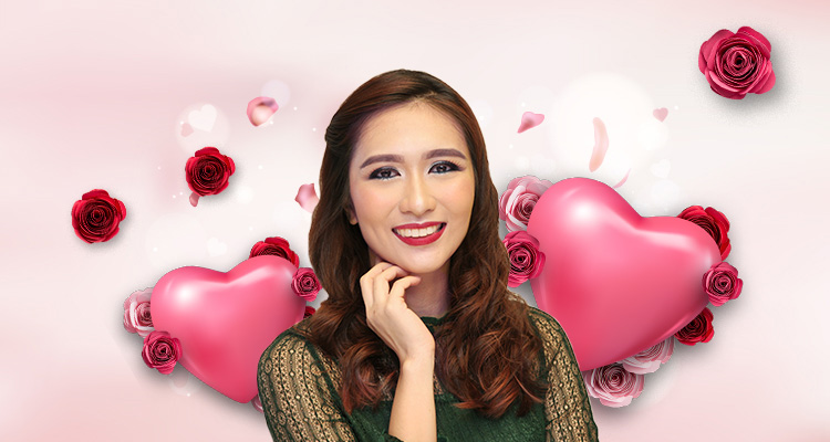 Woman wearing sexy makeup for Valentine's Day against a backdrop of hearts and roses