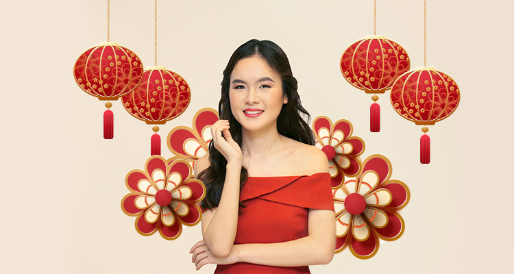 Woman wearing fresh makeup for Chinese New Year against a backdrop of lanterns and flowers